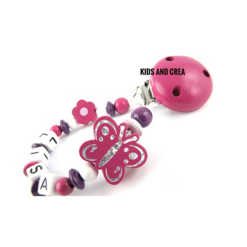 attache-tetine-fleur-papillon-fushia-kidsandcrea
